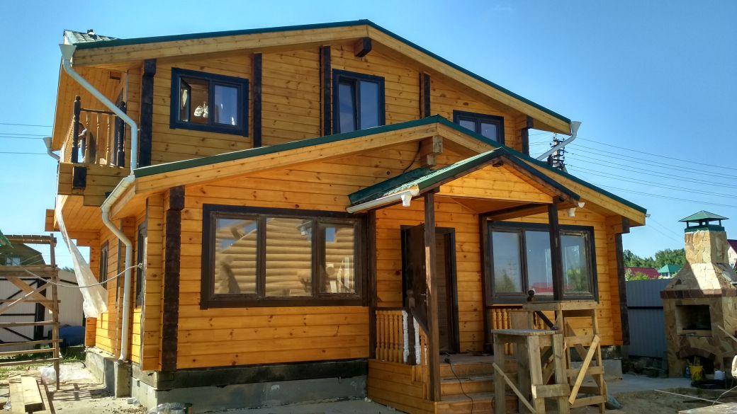 Двухэтажный дом из клеёного бруса 180 х 200 мм с террасой в д. Ланшино Московской области